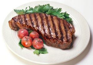 Steak on dinner plate